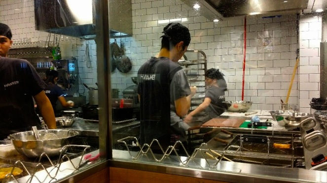 Looking into the kitchen from the front of the restaurant - deep frying the spring rolls